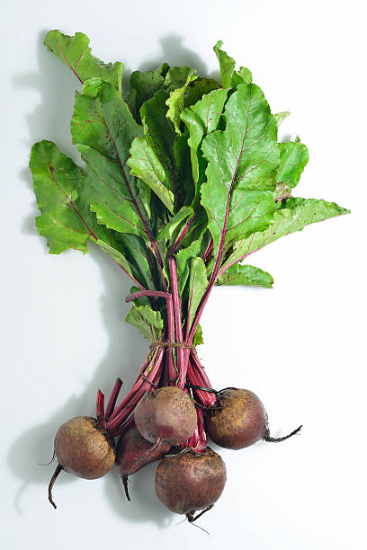 Bunch of Beetroot with Green Leafs on White Background stock photo