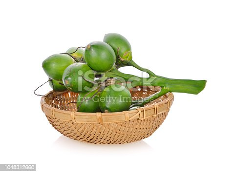 bunch of betel nuts in bamboo basket on white background