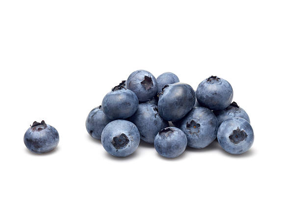 bunch of blueberries on white - blueberry stock pictures, royalty-free photos & images