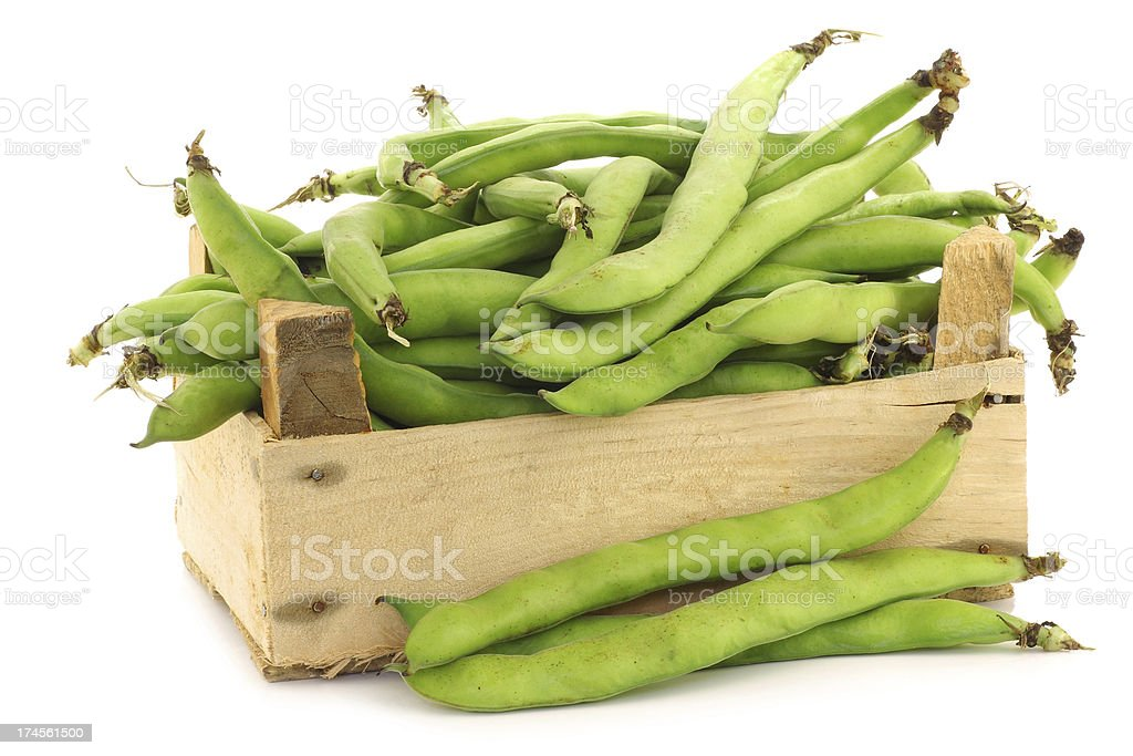bunch of broad beans in a wooden box royalty-free stock photo