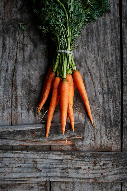 bunch of carrots - carrots stock photos and pictures