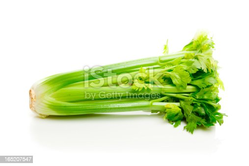 Bunch of celery isolated on white on a reflective surface.