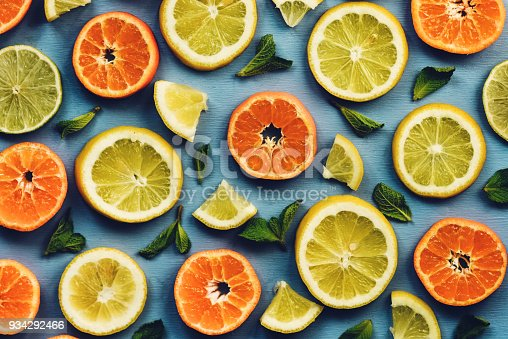 Tangerines in the shape of a Christmas tree on the dark green background. Top view. Christmas or New Year. Copy space.