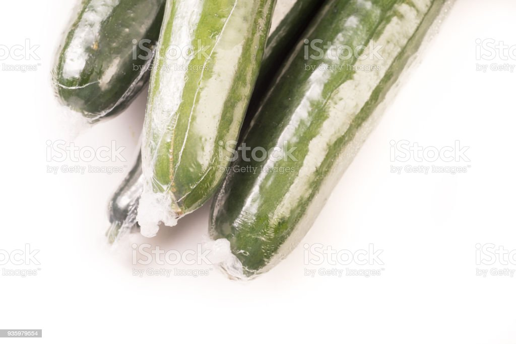 Bunch of cucumber wrapped in plastic films stock photo