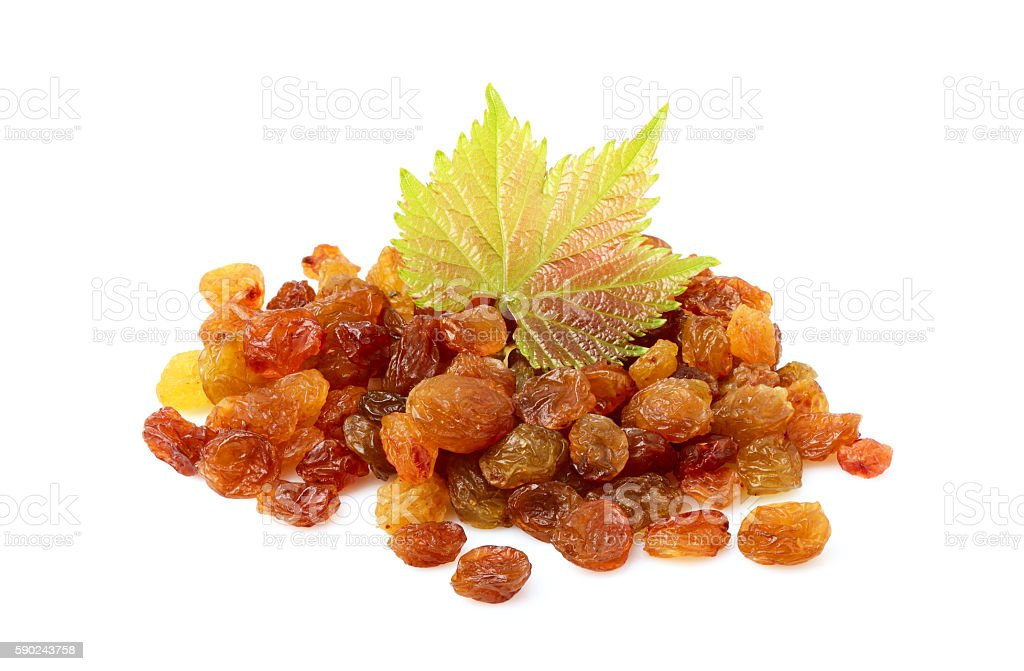 Bunch of dry raisins with a green leaf vine. stock photo