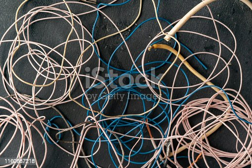 istock bunch of electronic wires or caples in colorful isolation on the table, connection concept 1160687218