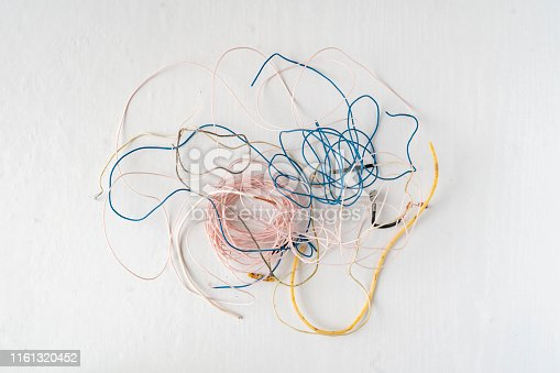 istock bunch of electronic wires or caples in colorful isolation on the table, connection concept 1161320452