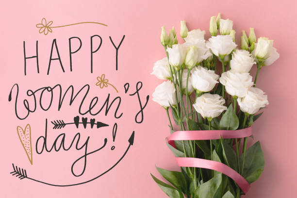 bunch of flowers and women's day greeting - womens day stock photos and pictures