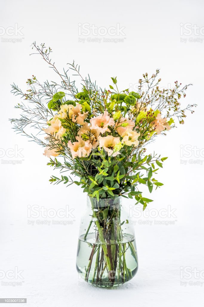 Bunch of flowers bouquet in a vase stock photo