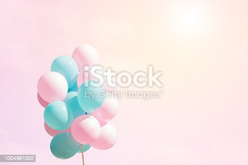 istock Bunch of flying balloons on soft background 1004961302