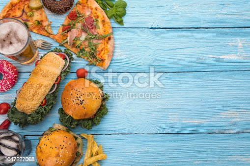 istock Bunch of food on Blue Picnic Table 1047227068