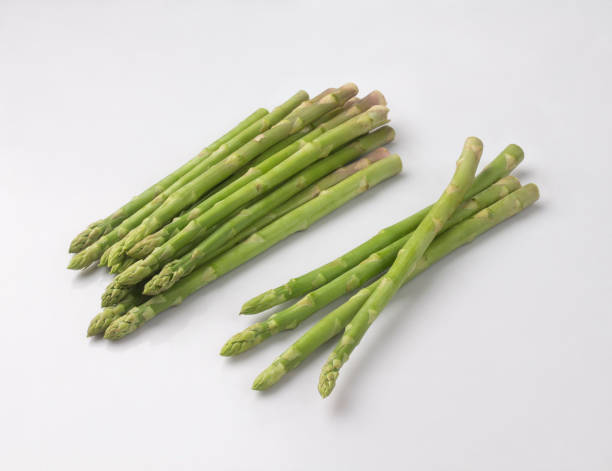 Bunch of fresh asparagus isolated on white stock photo