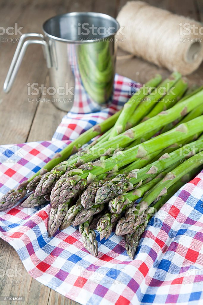 Bunch of fresh green asparagus spears on the table royalty-free stock photo