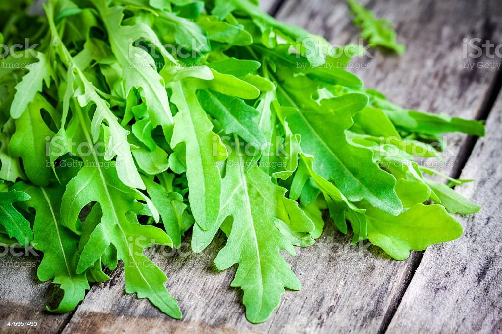 bunch of fresh organic arugula closeup stock photo