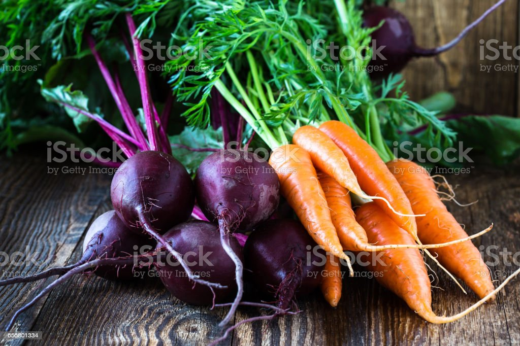 Bunch of fresh organic beetroots and carrots stock photo