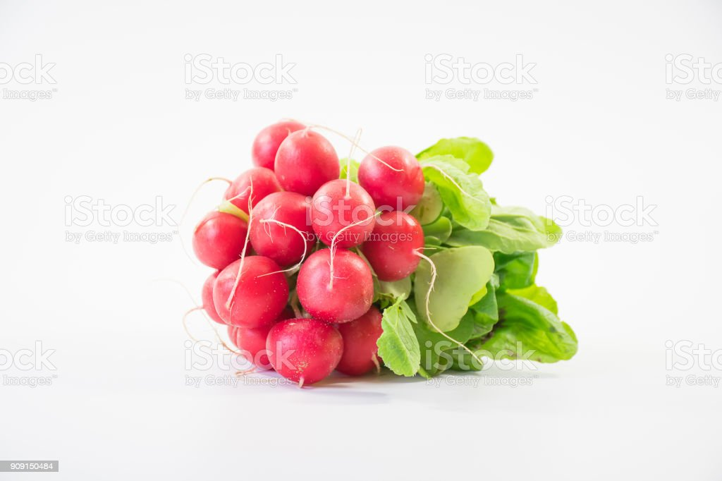 Bunch of fresh small red purple radishes on isolated white background stock photo