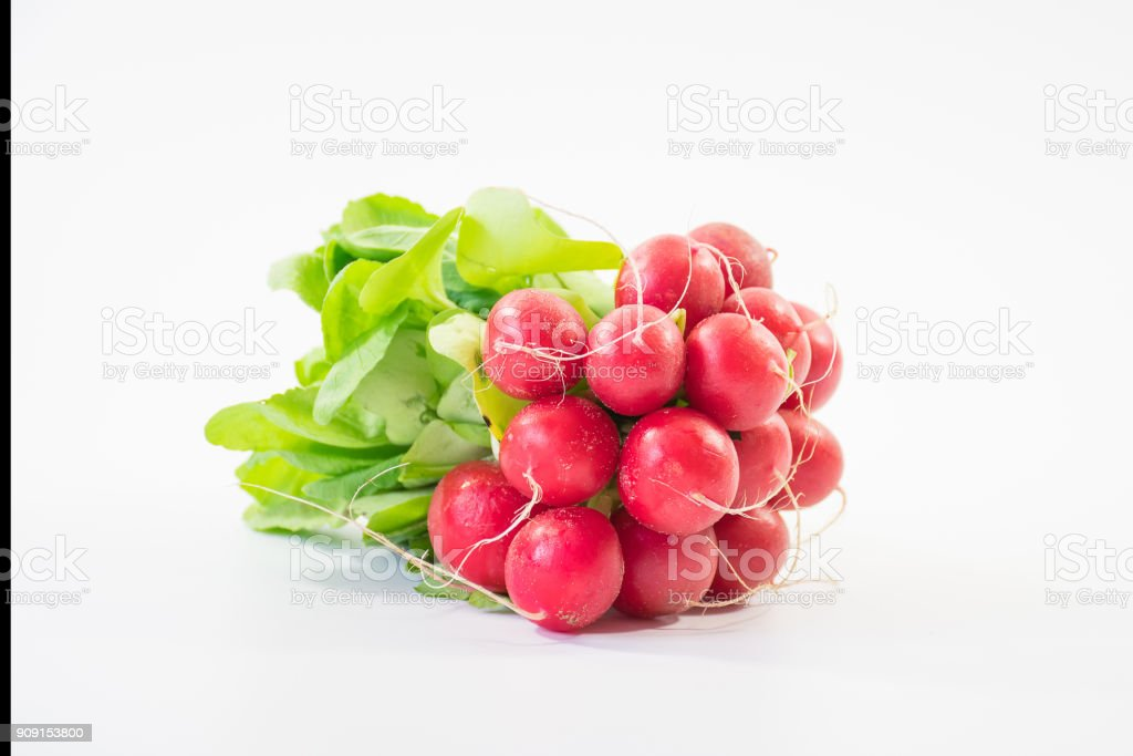 Bunch of fresh small red purple radishes on isolated white background1 stock photo
