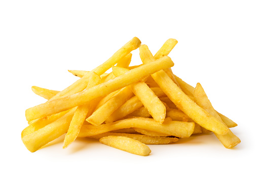 A bunch of fried French fries on a white background, close-up.