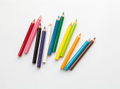 Bunch of fun mini colored pencils isolated on white. Multicolor group of cute small wooden pencils
