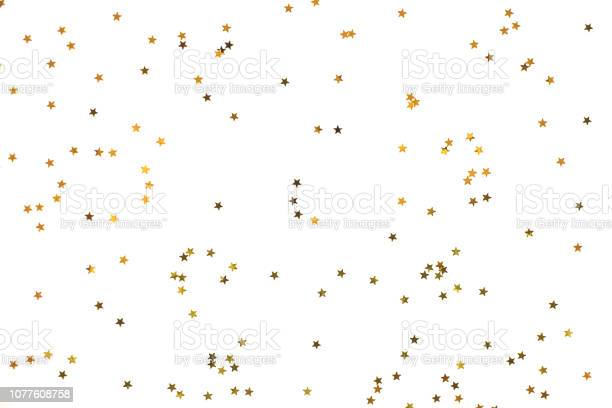 Photo of Bunch of gold stars on white background.