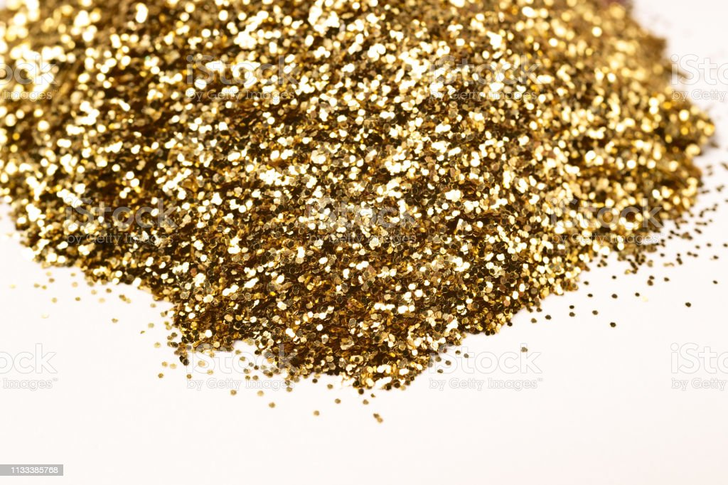 A bunch of golden nail gritter for manicure. Golden glitter shining...