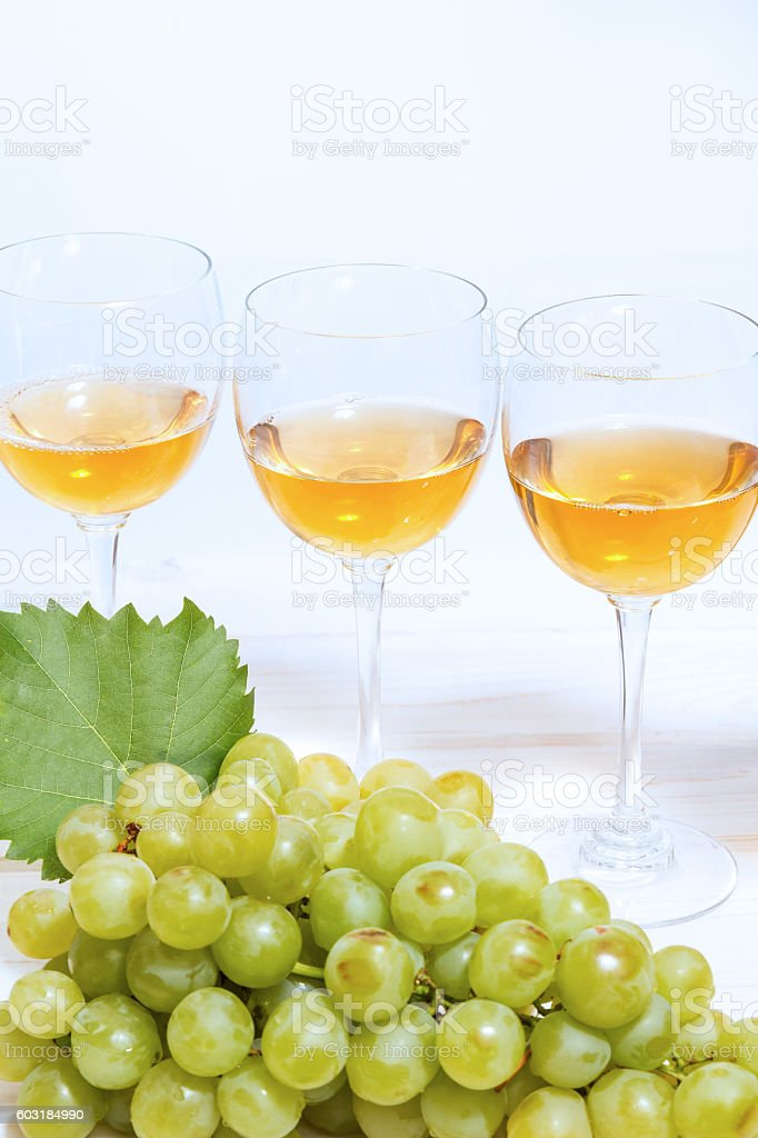 Bunch of grapes and wine glasses stock photo