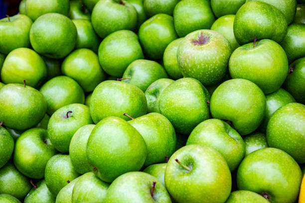 Bunch of green apples in supermarket Food, Vegetable, Apple - Fruit, Green Color, Granny Smith Apple granny smith apple stock pictures, royalty-free photos & images