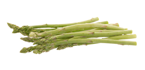 istock Bunch of green asparagus isolated on white background 814528638