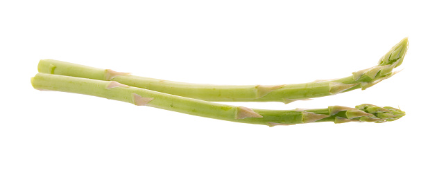istock Bunch of green asparagus isolated on white background 814528640