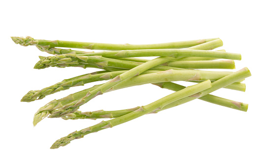 istock Bunch of green asparagus isolated on white background 817663092