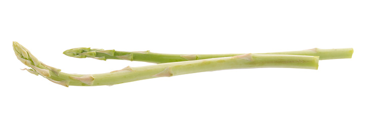 istock Bunch of green asparagus isolated on white background 817663610