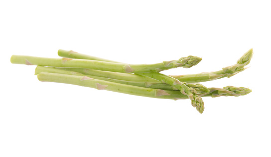 istock Bunch of green asparagus isolated on white background 821425728