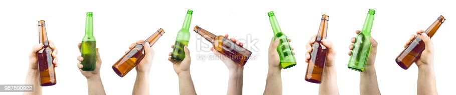 Bunch Of Hands Holding Ice Cold Wet Brown And Green Beer Bottles Isolated On White