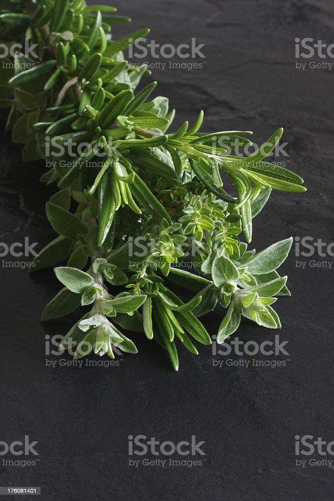 bunch of herbs o black slate royalty-free stock photo
