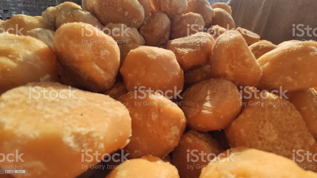 Bunch of Jaggery food sweet candies at production plant Bunch of Jaggery food sweet candies at production plant Abstract Stock Photo