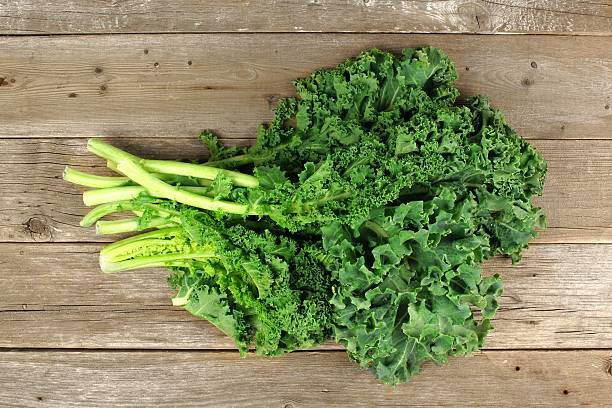 Bunch of kale over a wooden background stock photo