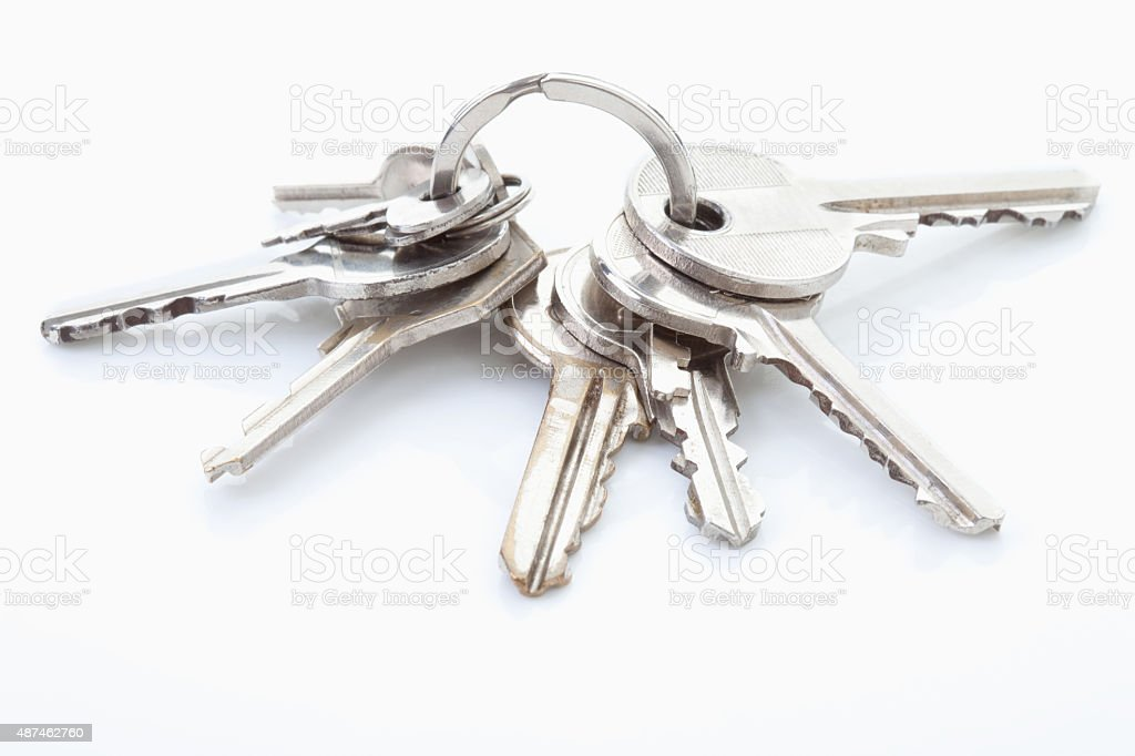Bunch of keys on white background stock photo