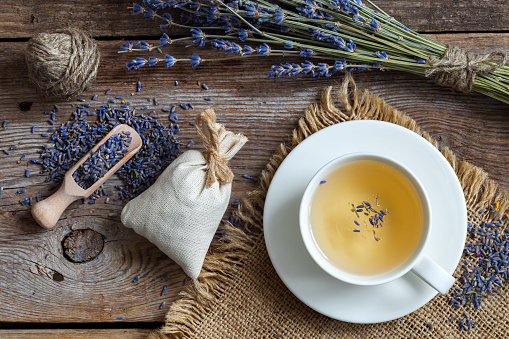 istock Bunch of lavender flowers, sachets and lavender tea cup. 626832174