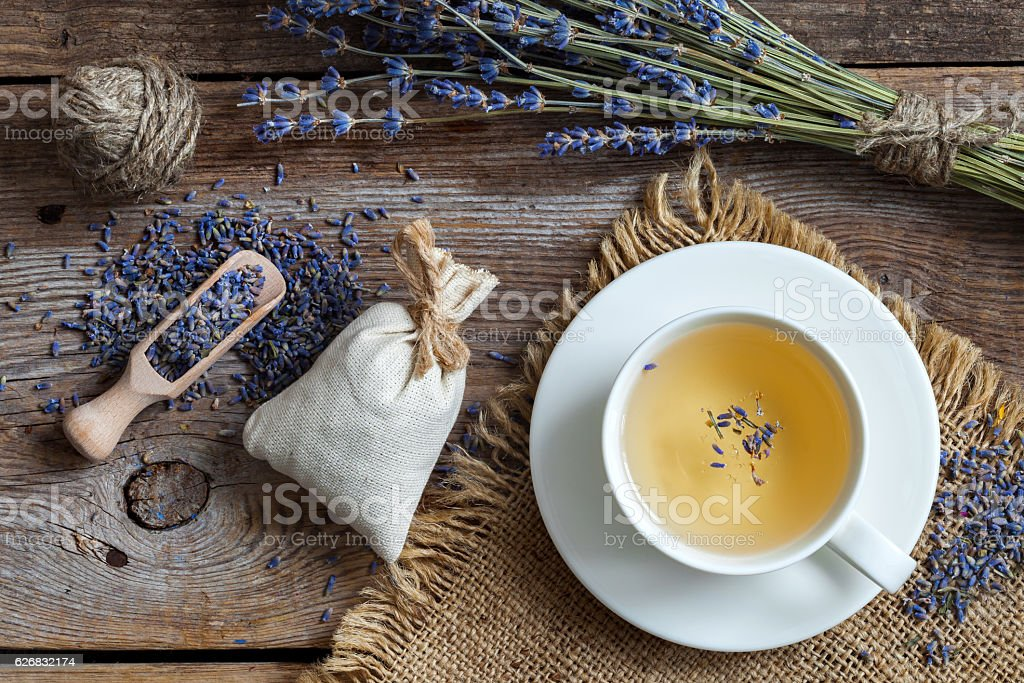 Bunch of lavender flowers, sachets and lavender tea cup. stock photo