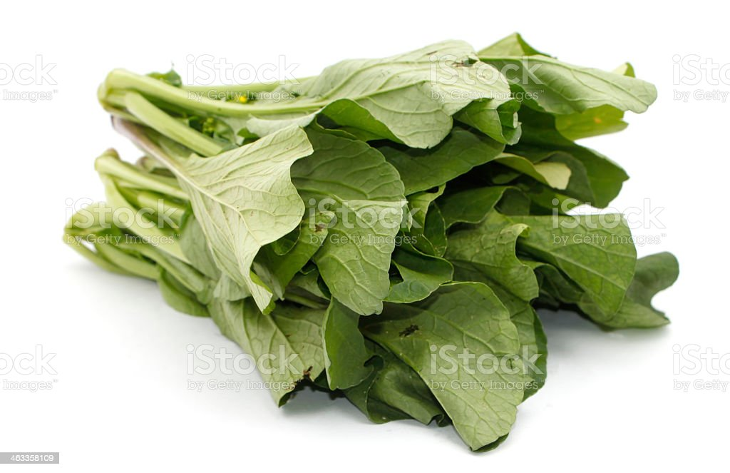 Bunch of leafy mustard greens isolated on white background stock photo