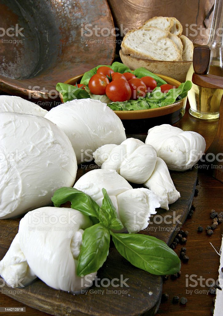 A bunch of little bags with mozzarella cheese inside of them stock photo