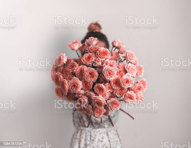 Photo of Bunch of Living Coral roses