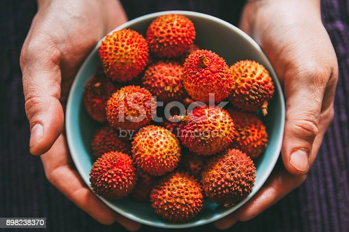 Bunch of Lychees in a bowl. Fresh and healthy fruits. Food background