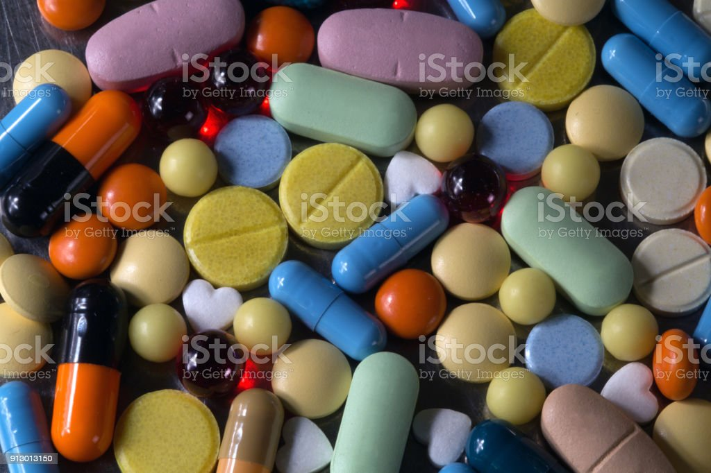 A bunch of multicolored tablets and capsules stock photo