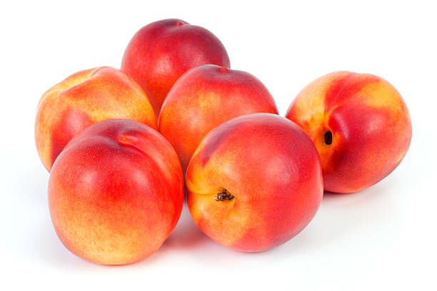 Bunch of nectarines on white table  stock photo