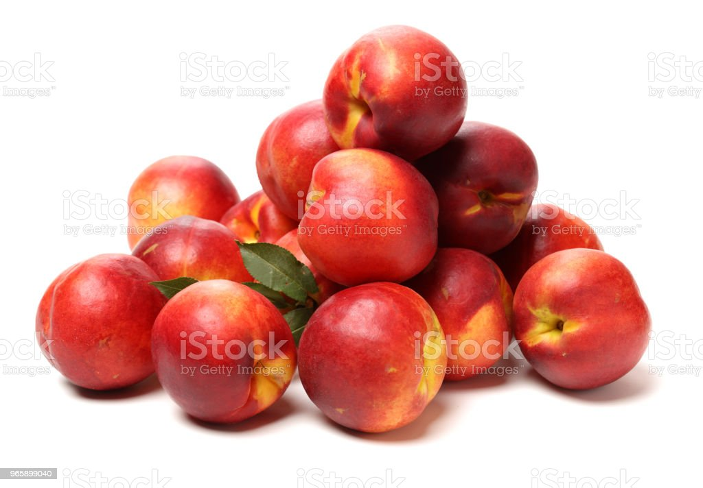 Bunch of nectarines on white table - Royalty-free Basket Stock Photo