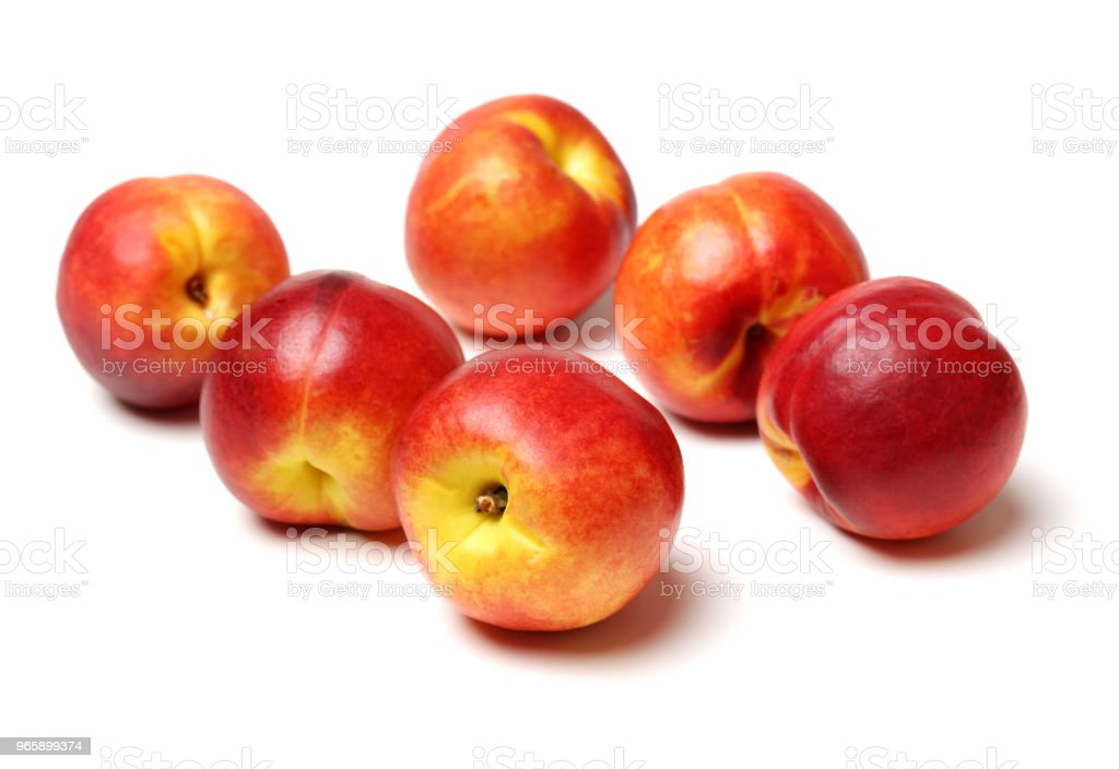 Stelletje nectarines op witte tafel - Royalty-free Bontgekleurd Stockfoto