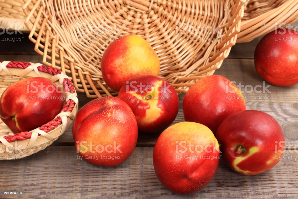 Bunch of nectarines on wood  table stock photo