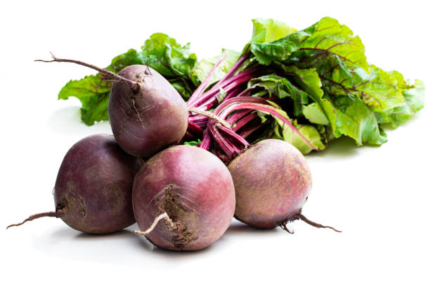 Bunch of new beetroots isolated on white Bunch  of new beetroots isolated on white beet stock pictures, royalty-free photos & images