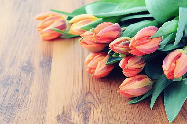 Bunch of orange tulips on wooden background with copy space picture id506704802?b=1&k=6&m=506704802&s=612x612&w=0&h=uncx wg0nu2n1sday3zrxi3oiac1pbmvvy6g6ev1me0=